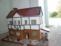 Dolls house about 1930's in good condition for age.