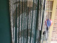 Shell Beaded Curtain with 60 Strands. The dolphins