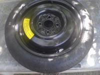 Donut Spare Tire from a 99 Ford Escort. Asking $25 obo.