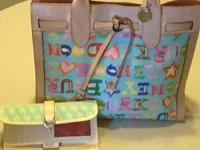 Dooney & Bourke handbag with checkbookn wallet.