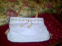 I am selling a lot of my purses. This is authentic and