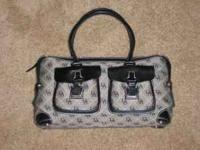 USED DOONEY & BOURKE PURSE, EXCELLENT CONDITION.