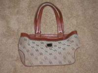 USED DOONEY & BOURKE PURSE IN VERY GOOD TOEXCELLENT