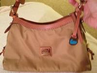 "Up for sale is a ""Like New"" Dooney & Bourke All Weather"