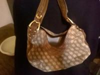 Genuine Dooney & Bourke Handbag. New condition.