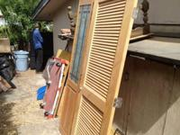 one unfinsihed 30 inch by 6ft, 8 inch louvered Door