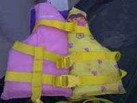 Dora life vest. Up to 50 lbs. $5.  Location: north
