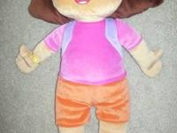 A charming Dora the explorer pillow that resembles a