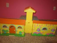 I have a Dora the Explorer yellow 2 story dollhouse for