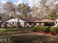 2 Homes In One On This Well Maintained Brick Ranch W/