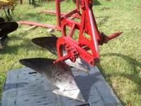 OLDER 14 INCH DOUBLE PLOW IN GOOD CONDITION FOR $300