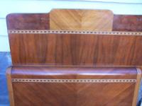 This double bed has a nice inlaid wood design which I
