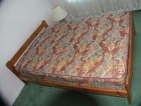 Double bed frame with mattress. Photo of mattress