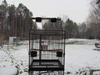 Dark grey california cage. Each cage is 24 inches wide,