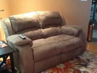 Double recliner/couch. Like brand-new. No tears, stains