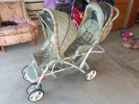 DOUBLE STROLLER IN GOOD CONDITION WOULD KEEP BUT