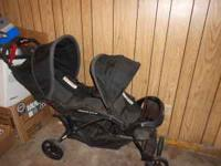 Kolcraft Black double stroller, good condition. $80.