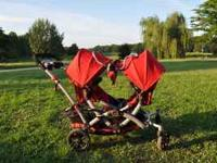 Like new double stroller folds up to fit in vehicle,