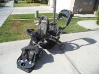 Double stroller that converts to a sit and stand,