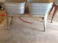 Set of wash tubs with stand.  Tubs are in great