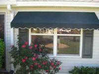 THIS IS A DOUBLE WINDOW AWNING COMES FROM A MANDEVILLA