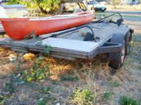 I have a double axel flatbed car hauler trailer for