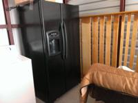 black Maytag refrigerator with icemaker 5 years old.