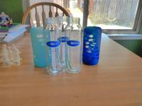 3- 7 oz 3- 3.5 oz glass bottles 2 silicone glass