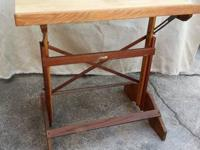 This is a mid century modern drafting table.  You can