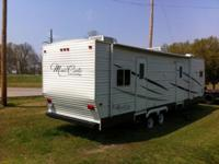 2011 MONTE CARLO TRAVEL TRAILER. BRAND NEW---NEVER