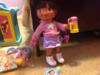 I am selling 2 dress up Dora dolls, the wardrobe closet