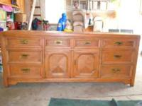 Solid wood triple dresser, finished in light pecan