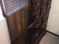 Very solid dresser with a glass top. Some wear, but