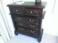 Beautifully detailed wood dresser. Crack on left side