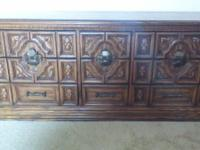 Very nice dresser and matching night stand.  Oak color,