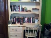 This is a blonde color book case/desk with chair, and a