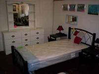 Selling is a dresser having 9 drawers and a mirror. It