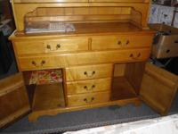 TWO PIECE GLASS AND WOOD HUTCH IN NICE CONDITION. TOP