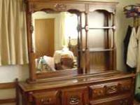 This is a very nice dresser with a large mirror. the