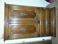 Armoire dark walnut in color. This Armoire is designed