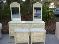 Dresser with 2 mirrors and 2 night stands. Made of wood