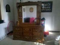 9 drawer dresser with mirror in good shape. call or