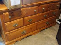 This is a great dresser with 2 nightstands. Has some