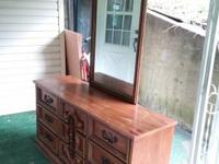 This is a 9 drawer dresser with a vanity type mirror.