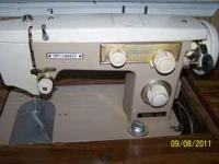 Dressmaker model 500 Sewing machine with stand. $50.00