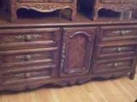 This is an antique dresser with two nightstands made by