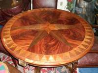 Rarely used gold leaf drexel table. It is round and