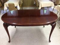 Carleton Cherry Collection dining room table was