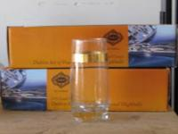 2 sets of gold rim drinking glasses total of 8 glasses
