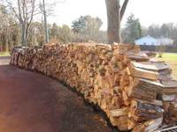 All the wood is stacked next to my driveway for